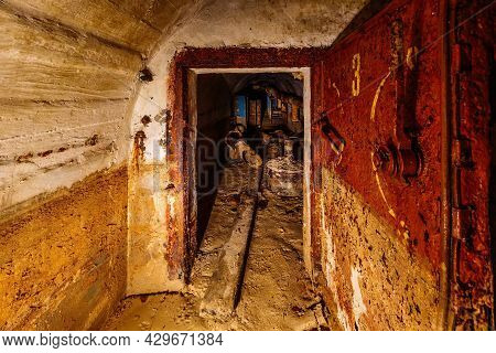 Rusted Metal Armored Door In Old Abandoned Dirty Soviet Bunker