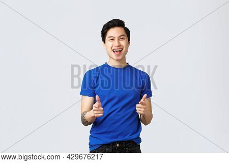 People Different Emotions, Lifestyle And Casual Concept. Cheerful Upbeat Asian Man In Blue T-shirt,