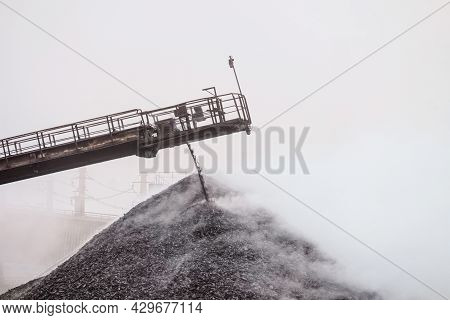 Hot Briquetted Iron Are Piled From The Conveyor Belt Into A Heap. Falling Of Lumps Ore Concentrate.