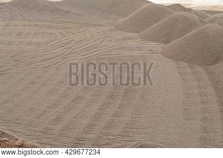 Outdoors Warehouse Of Mining And Processing Plant With Dunes Made Of Iron Briquettes. Hot Iron Briqu