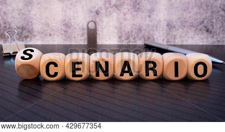 Scenario Word On Wooden Cube Isolated On Orange Background.