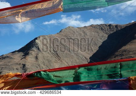 Prayer Flags In Front Of The Mountains Of The Himalaya. The Amazing Landscape Of Tibet. Colorful Pra
