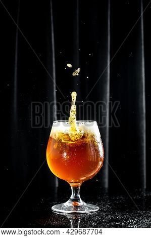 Beer. Cold Craft Light Beer In A Glass With Water Drops. Pint Of Beer Into A Tall Glass With A Thick
