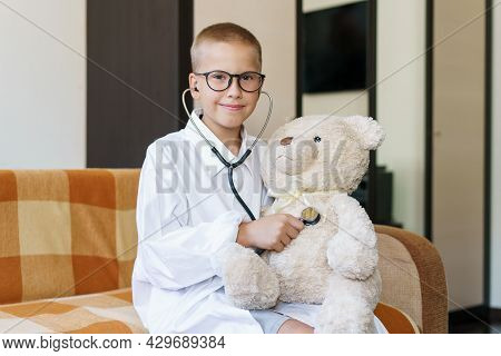 Cute Little Caucasian Boy Playing Funny Game Like Doctor Holding Stethoscope Listening To Toy Presch