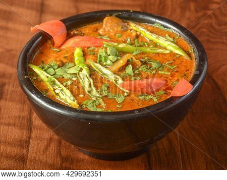 Mutton Handi Or Lamb Curry, Spicy And Delicious Dish Served Over A Rustic Wooden Background, Selecti