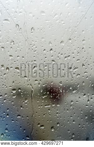 Raindrops On The Window. Drops Of Condensation Water And Wet On The Glass Background. Rainy Cloudy W