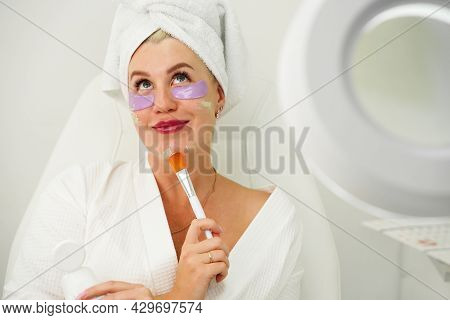 Close Up Of Woman With Natural Makeup Applying Corrector On Flawless Fresh Skin, Doing Make Up. Girl
