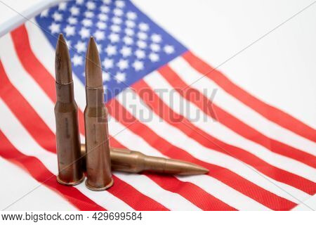 Cartridges From Automatic Weapons On The Usa Flag. American Flag With Shotgun Cartridges.