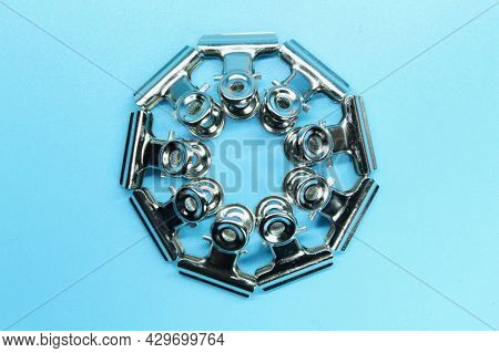 Iron Clamps Are Arranged In A Circle. Creative Concept