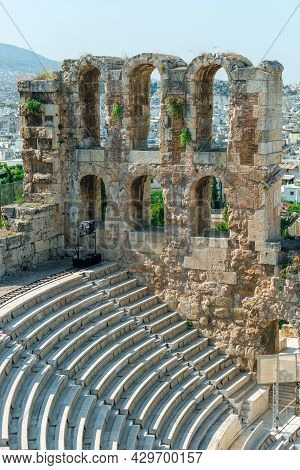 Ancient Odeon Of Herodes Atticus In Athens, Greece On Acropolis Hill