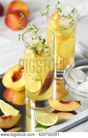 Peach Summer Cocktail. Refreshing Organic Non-alcoholic Drink, Lemonade With Ripe Nectarine, Thyme A