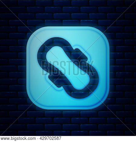 Glowing Neon Menstruation And Sanitary Napkin Icon Isolated On Brick Wall Background. Feminine Hygie