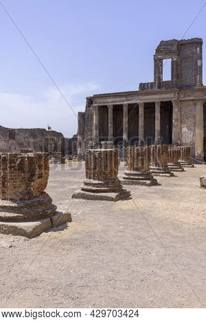 The Forum Of Pompeii With Remains Of Basilica, Pompeii, Naples, Italy. Ruins Of An Ancient City Dest