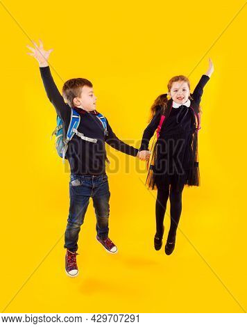The Couple Of Classmates Are Jumping And Holding Hands