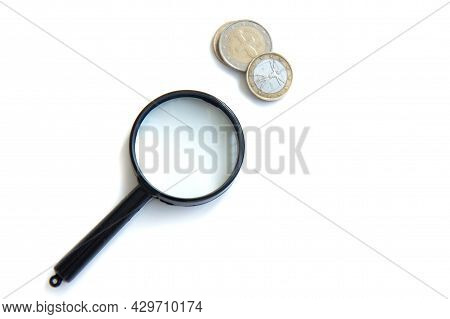 Magnifier And Stack Of Coins Isolated On White Background. Concept Of Keeping Money, Investing. Flat