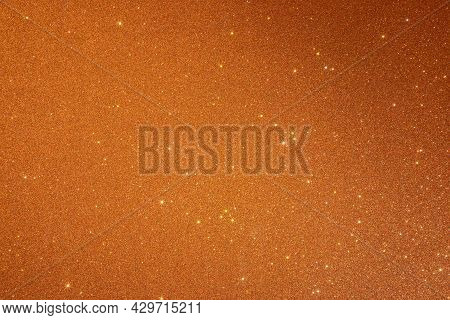Orange Texture With Sparkles And And A Shadow From The Top Right Corner. Sparkling Stars Effect (mic