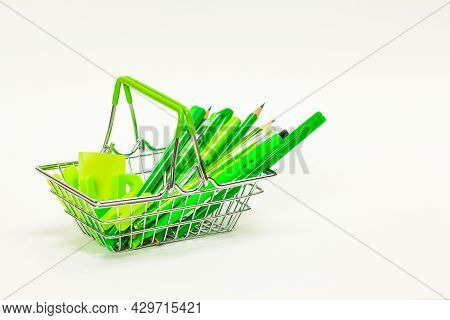 The Concept Of Going Back To School. School Supplies Of Green Color, Pencils, Pens, Markers, Paper C