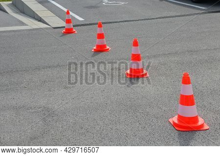 Traffic Cones Are A Necessary Aid, Especially When Repairing Roads And Sidewalks, Warning Drivers An