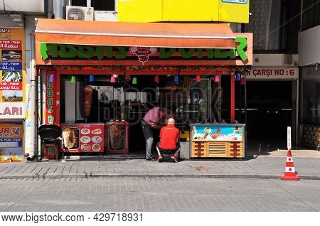 View Of A Street Cafe In Istanbul. Men Prepare Street Food. 09 July 2021, Istanbul, Turkey.