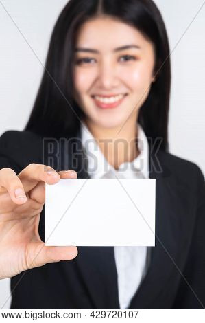 Business Asian Woman In Black Suit Holding And Showing Empty Blank Business Card Or Blank Name Card