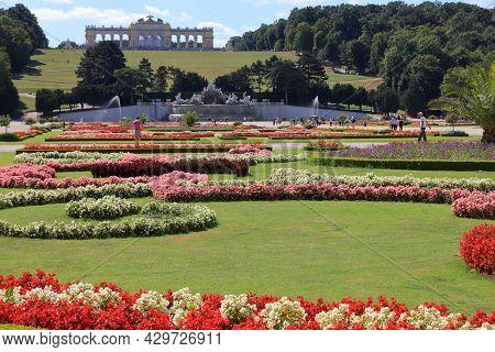 Vienna, Austria - September 6, 2011: People Visit Schoenbrunn Gardens In Vienna. Palace And Gardens