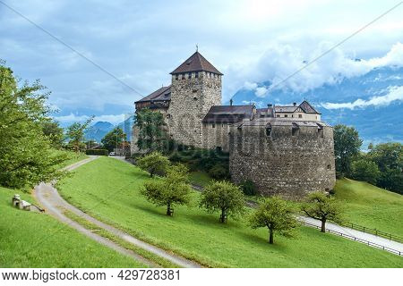 View Of Vaduz Castle, The Official Residence Of The Prince Of Liechtenstein On The Alpine Background