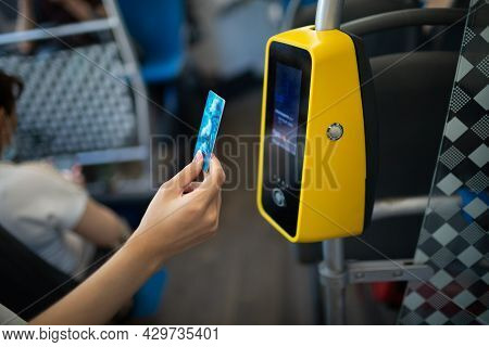 Asian Woman Hand Paying Conctactless With Plastic Card For The Public Transport In Bus, Tram Or Subw