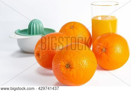 Ripe Bio Oranges And A Glass Of Fresh Squeezed Orange Juice On White Wooden Background. Organic Sici
