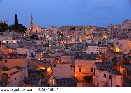 Sassi Districts Of Matera Italy Night View. Ancient Town In Basilicata Region. Unesco World Heritage