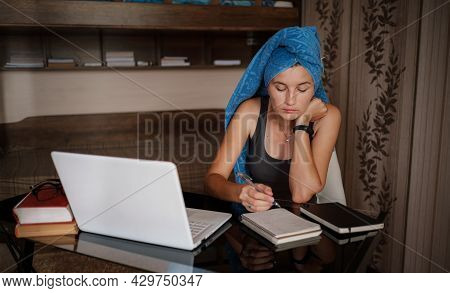 Woman With Blue Towel On Head Is Working Office Work Remotely From Home. Using Computer. Distance Le