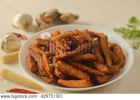Crisp Fried Baby Corn Or Baby Corn Fritters Prepared By Deep Frying Steamed Baby Corn Dipped In A Sp
