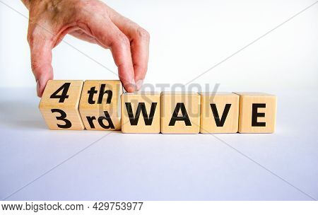 Symbol For A Fourth Wave Of The Covid-19 Corona Virus. Doctors Turns Cubes And Changes Words '3rd Wa