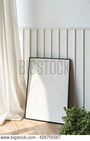 Blank picture frame on the parquet floor