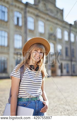 College Girl, Student Portrait, Studying Abroad Or Educational Concept. Cheerful Smiling Young Blond