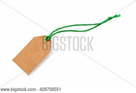 Blank Cardboard Tag On A Green Jute Ribbon Isolated On White Background. Empty Brown Paper Label Wit