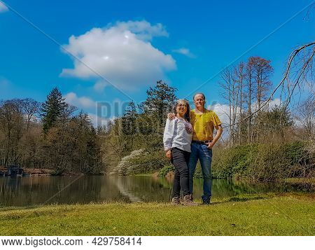 Happy Multicultural Couple, A Mexican Woman And A Dutch Man With A Lake Surrounded By Bare Trees In