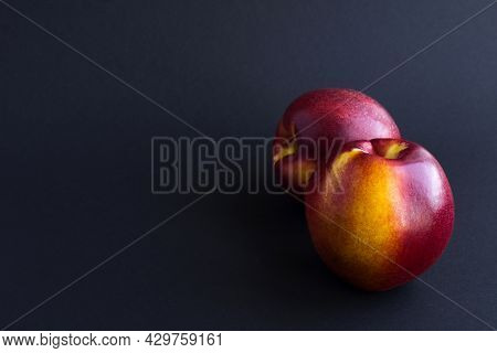 Close-up On Ripe Nectarine On The Black Background. Copy Space.