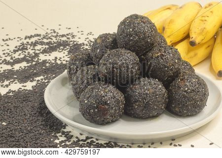 Traditional Indian Sweet Balls Made With Sesame Seeds, Jaggery And Coconut, Commonly Known As Til Ke