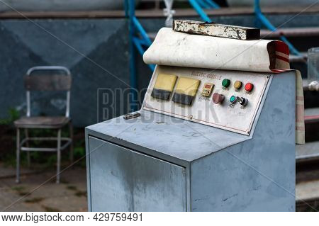 Old Electronic Control Console With A Key. Metal Surface With Buttons And Indicators.