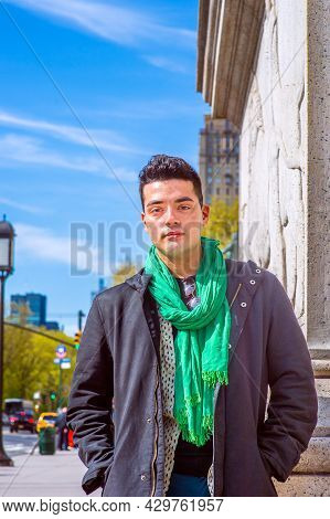 Under Sunshine In Early Spring, A Young Handsome Guy Is Standing On The Street,  Charmingly Looking