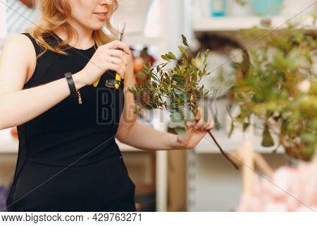 Florist Woman Make Bouquet In Flower Boutique.