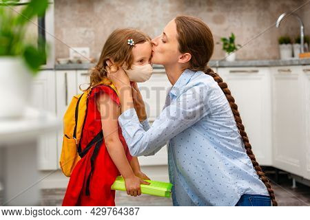 Child Going Back To School. Mother And Kid Getting Ready For First School Day After Vacation. Little