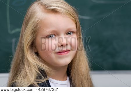 Close Up Portrait Of Beautiful Girl. Adorable Blonde Long Haired Girl Posing On Background Of Blackb