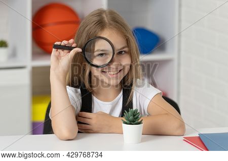 Investigate With Loupe. Science And Childhood. Teen Girl Looking At Plant Through Magnifier