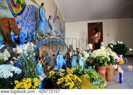 Salvador, Bahia, Brazil - August 13, 2021: Woman Is Seen In A Shrine In Honor Of The Orixa Yemanja I