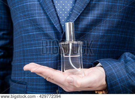 Fresh Fragrance For Everyday Use. Perfume Bottle On Male Hand. Perfume Spray. Eau De Toilette