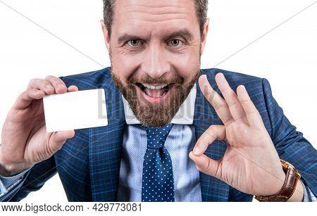 Happy Businessman Man In Businesslike Suit Showing Empty Debit Or Business Card For Copy Space