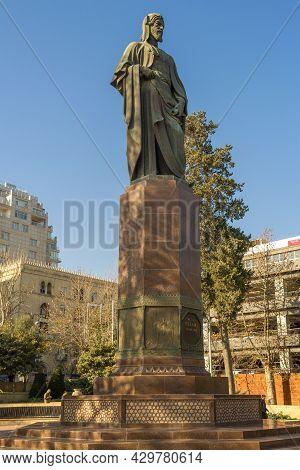 Baku, Azerbaijan - December 29, 2017: Monument To Medieval Persian Poet Nizami Ganjavi On A Sunny De