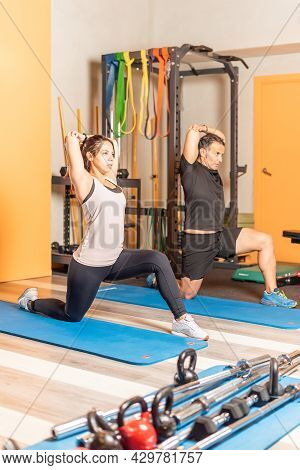 Athlete People Doing Triceps Stretching In Health Club