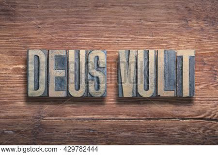 Deus Vult Ancient Latin Saying Meaning - God Wills, Combined On Vintage Varnished Wooden Surface